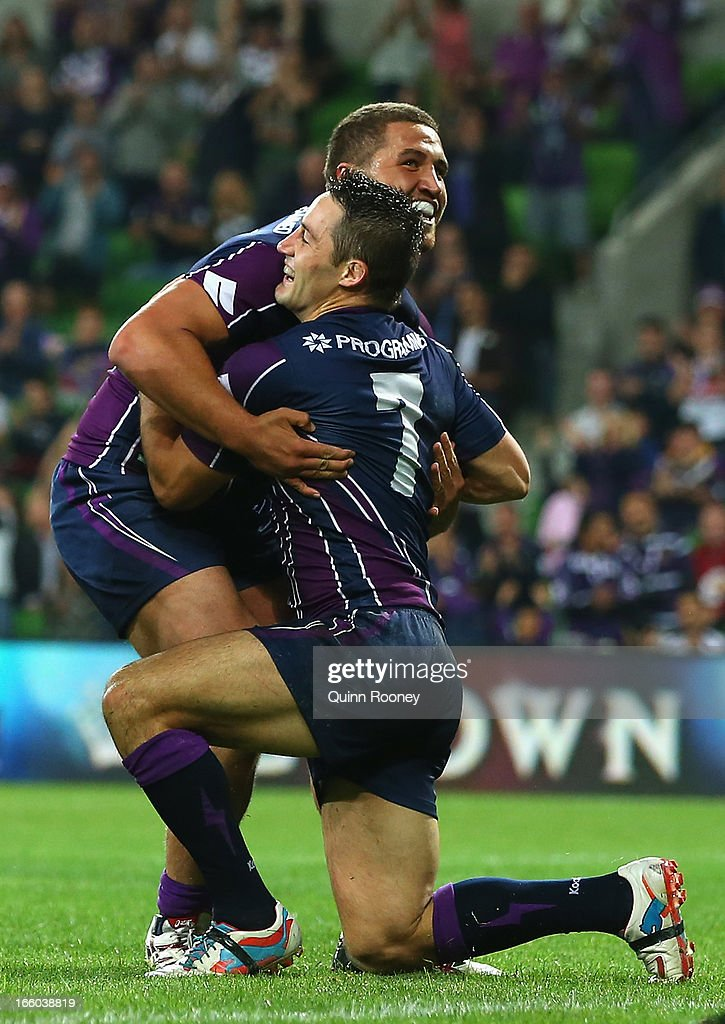 Cooper Cronk of the Storm is congratulated by Kenny Bromwich after scoring a try during the round 5 NRL match between the Melbourne Storm and the Wests Tigers at AAMI Stadium on April 8, 2013 in Adelaide, Australia.