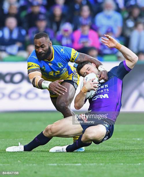 Cooper Cronk of the Storm is tackled by Semi Radradra of the Eels during the NRL Qualifying Final match between the Melbourne Storm and the...