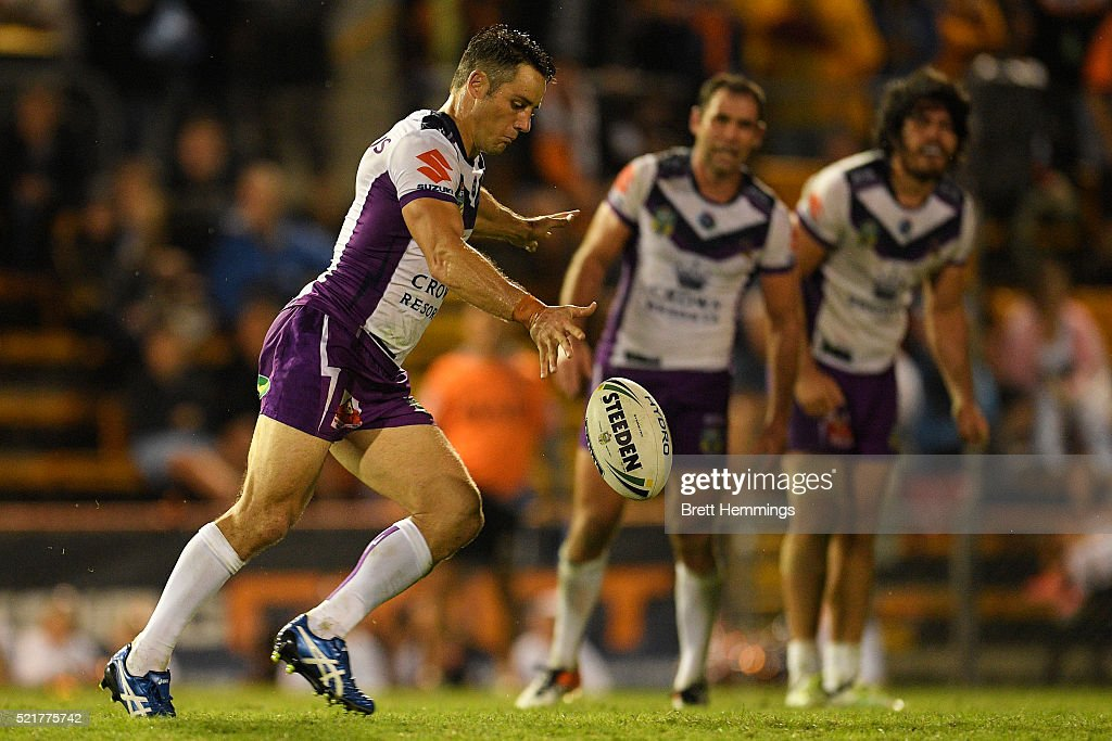 Cooper Cronk of the Storm kicks the winning field goal in extra time during the round seven NRL match between the Wests Tigers and the Melbourne Storm at Leichhardt Oval on April 17, 2016 in Sydney, Australia.