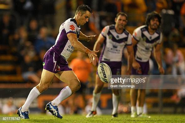 Cooper Cronk of the Storm kicks the winning field goal in extra time during the round seven NRL match between the Wests Tigers and the Melbourne...