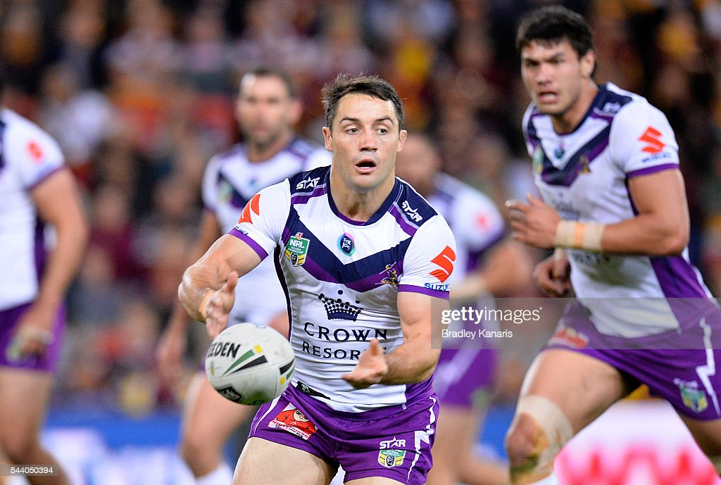 <a gi-track='captionPersonalityLinkClicked' href=/galleries/search?phrase=Cooper+Cronk&family=editorial&specificpeople=234620 ng-click='$event.stopPropagation()'>Cooper Cronk</a> of the Storm passes the ball during the round 17 NRL match between the Brisbane Broncos and the Melbourne Storm at Suncorp Stadium on July 1, 2016 in Brisbane, Australia.