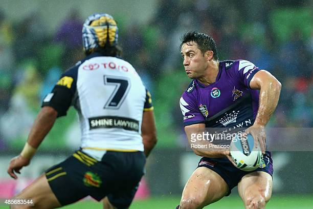 Cooper Cronk of the Storm prepares to offload the ball during the round 25 NRL match between the Melbourne Storm and the North Queensland Cowboys at...
