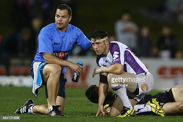 Cooper Cronk of the Storm receives attention from the trainer during the round 24 NRL match between the Penrith Panthers and the Melbourne Storm at...