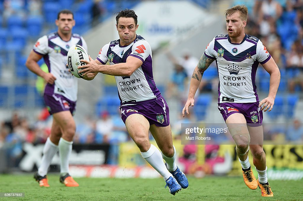Cooper Cronk of the Storm runs with the ball during the round nine NRL match between the Gold Coast Titans and the Melbourne Storm on May 1, 2016 in Gold Coast, Australia.