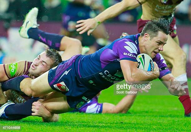 Cooper Cronk of the Storm scores a try during the round eight NRL match between the Melbourne Storm and the Manly Sea Eagles at AAMI Park on April 25...
