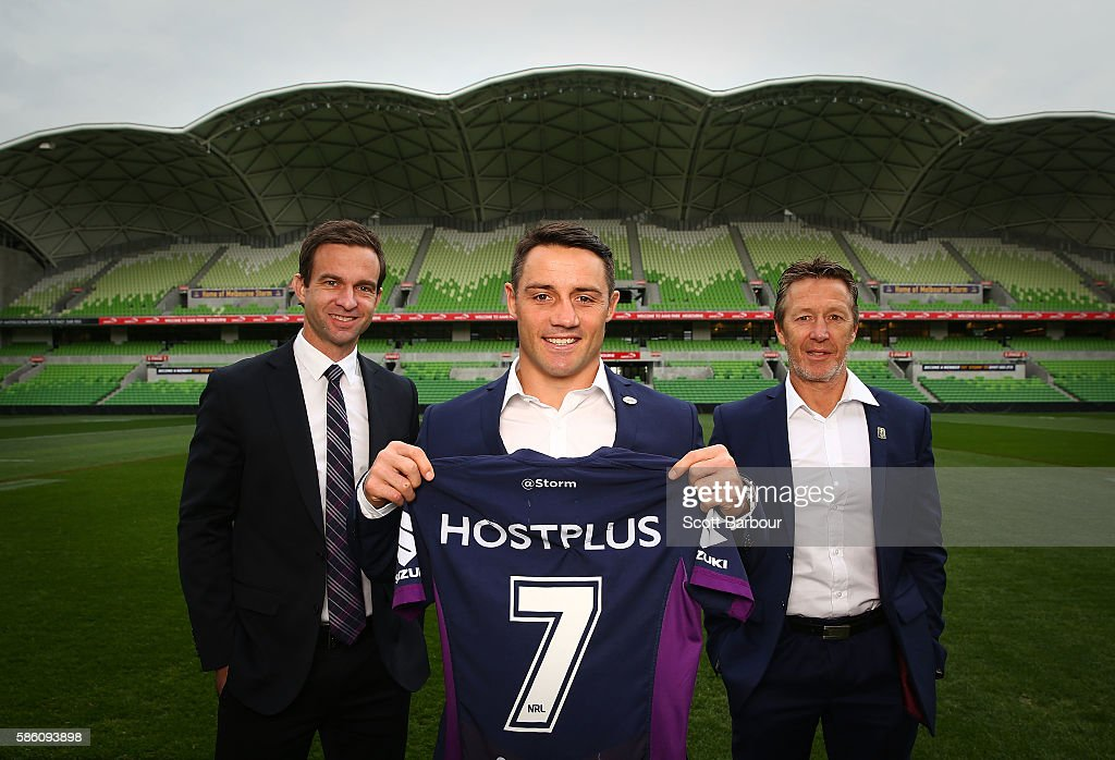 Cooper Cronk (C) of the Storm, Storm head coach Craig Bellamy (R) and Storm CEO Dave Donaghy pose during a Melbourne Storm NRL media opportunity at AAMI Park on August 5, 2016 in Melbourne, Australia. Cronk re-signed with the Storm until the end of 2018.