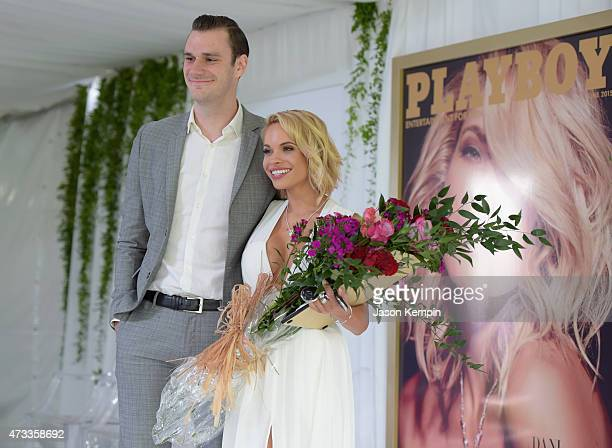 Cooper Hefner and 2015 Playmate of the Year Dani Mathers pose onstage during Playboy's 2015 Playmate of the Year Ceremony at the Playboy Mansion on...
