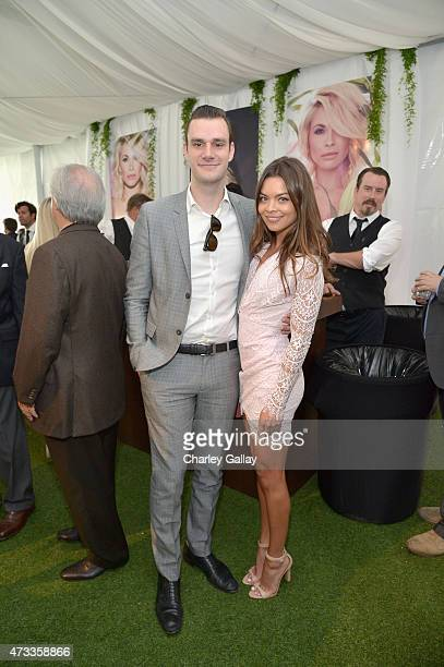 Cooper Hefner and actress Scarlett Byrne attend Playboy's 2015 Playmate of the Year Ceremony at the Playboy Mansion on May 14 2015 in Los Angeles...