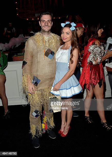 Cooper Hefner and actress Scarlett Byrne attend the annual Halloween Party hosted by Playboy and Hugh Hefner at the Playboy Mansion on October 24...