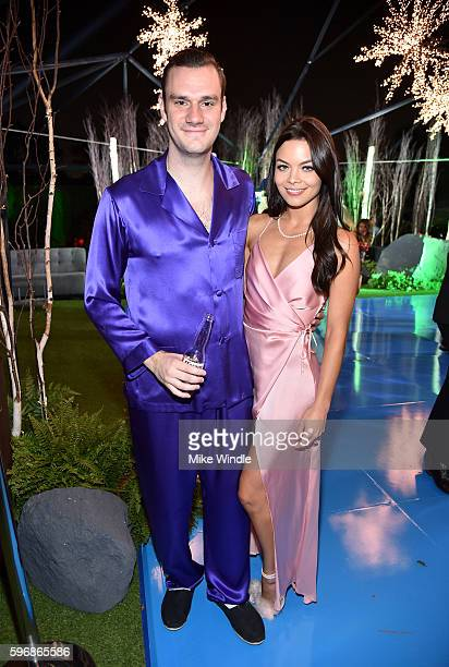 Cooper Hefner and actress Scarlettt Byrne attend the annual Midsummer Night's Dream party hosted by Hugh Hefner at The Playboy Mansion on August 27...