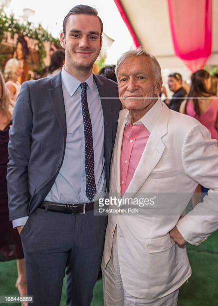 Cooper Hefner and Hugh Hefner attend Playboy's 2013 Playmate Of The Year luncheon honoring Raquel Pomplun at The Playboy Mansion on May 9 2013 in...