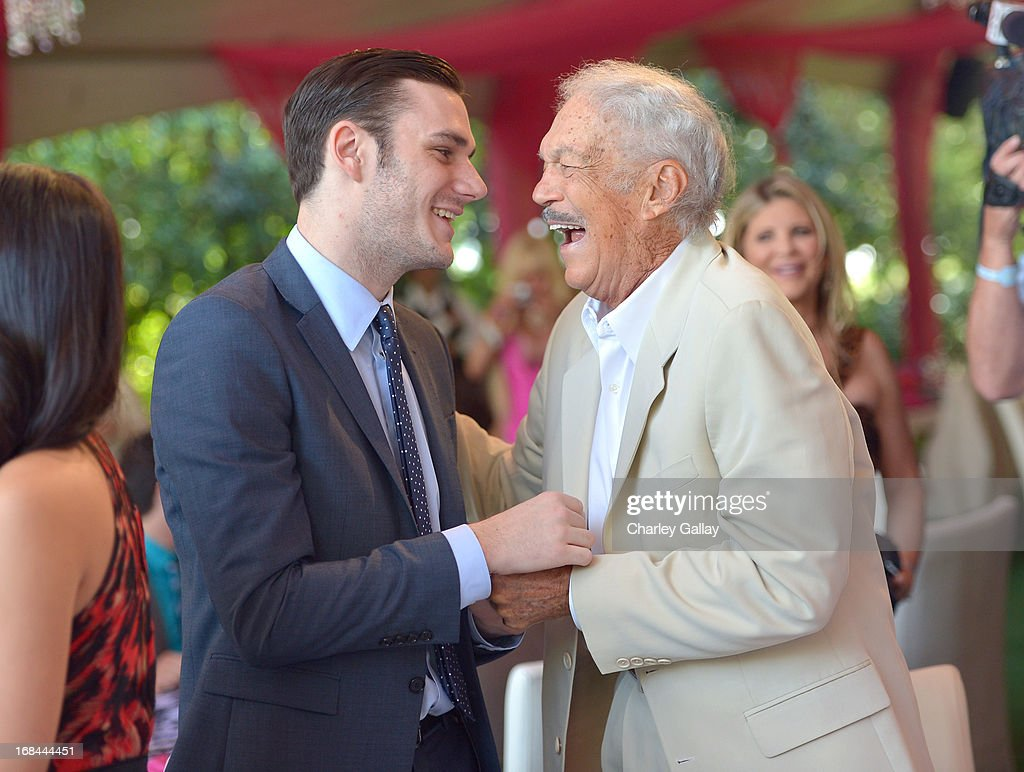 <a gi-track='captionPersonalityLinkClicked' href=/galleries/search?phrase=Cooper+Hefner&family=editorial&specificpeople=1521927 ng-click='$event.stopPropagation()'>Cooper Hefner</a> (L) and <a gi-track='captionPersonalityLinkClicked' href=/galleries/search?phrase=Keith+Hefner&family=editorial&specificpeople=3635830 ng-click='$event.stopPropagation()'>Keith Hefner</a> attend Playboy's 2013 Playmate Of The Year luncheon honoring Raquel Pomplun at The Playboy Mansion on May 9, 2013 in Holmby Hills, California.