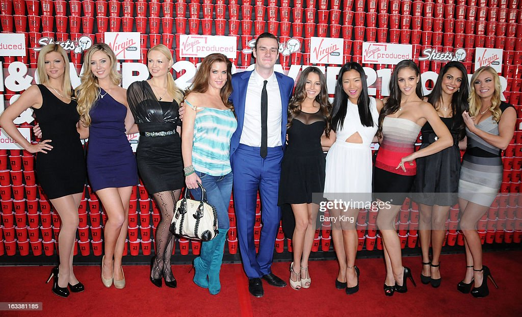 Cooper Hefner (C) and playmates arrive at the '21 And Over' - Los Angeles Premiere at Westwood Village Theatre on February 21, 2013 in Los Angeles, California.