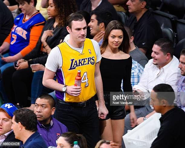 Cooper Hefner and Scarlett Byrne attend a basketball game between the New York Knicks and the Los Angeles Lakers at Staples Center on March 12 2015...