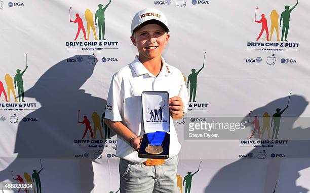 Cooper Jones poses with his trophy after winning the Overall competition in the Boys 1011 yr old Drive Chip and Putt regional qualifying at Chambers...