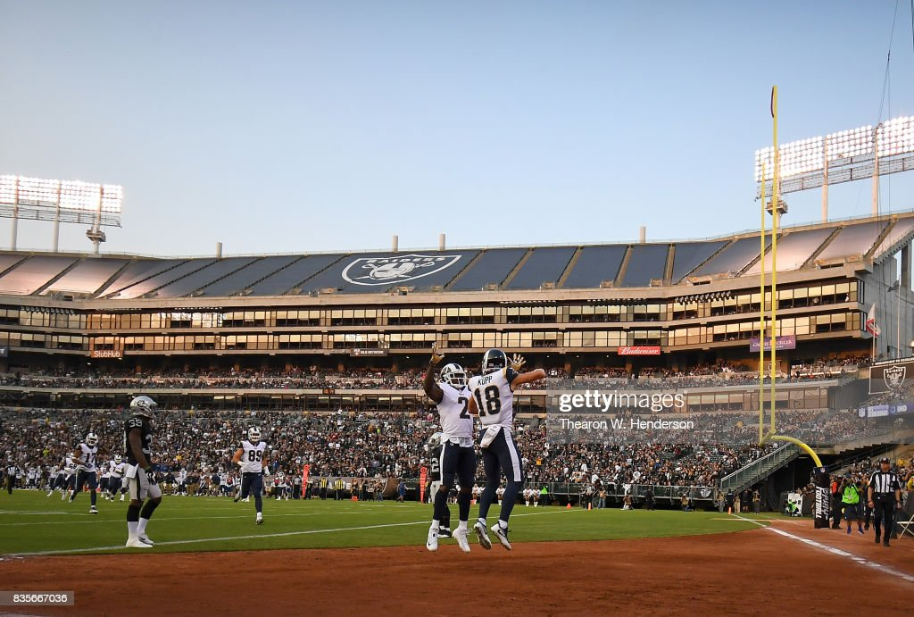 Cooper Kupp #18 and Sammy Watkins #2 of the Los Angeles Rams celebrates after Kupp scored a touchdown against the Oakland Raiders during the first quarter of their preseason NFL football game at Oakland-Alameda County Coliseum on August 19, 2017 in Oakland, California.