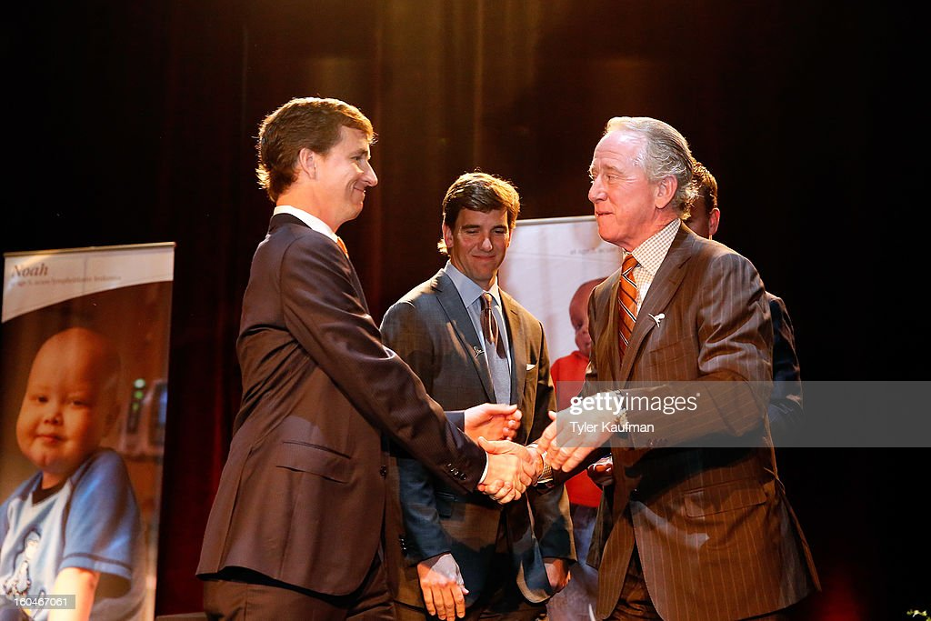 Cooper Manning, <a gi-track='captionPersonalityLinkClicked' href=/galleries/search?phrase=Eli+Manning&family=editorial&specificpeople=202013 ng-click='$event.stopPropagation()'>Eli Manning</a>, Peyton Manning, and father <a gi-track='captionPersonalityLinkClicked' href=/galleries/search?phrase=Archie+Manning&family=editorial&specificpeople=453294 ng-click='$event.stopPropagation()'>Archie Manning</a> attend the 2013 Legends For Charity Dinner where Archie was honored at the Hyatt Regency New Orleans on January 31, 2013 in New Orleans, Louisiana.