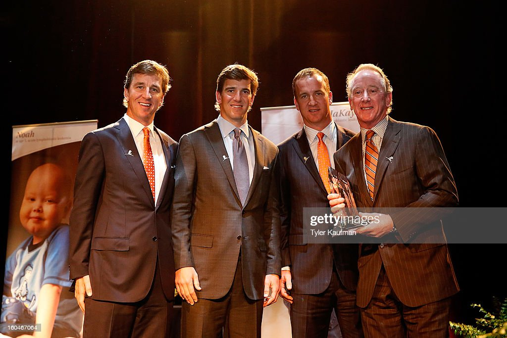 Cooper Manning, Eli Manning, Peyton Manning, and father Archie Manning attend the 2013 Legends For Charity Dinner where Archie was honored at the Hyatt Regency New Orleans on January 31, 2013 in New Orleans, Louisiana.