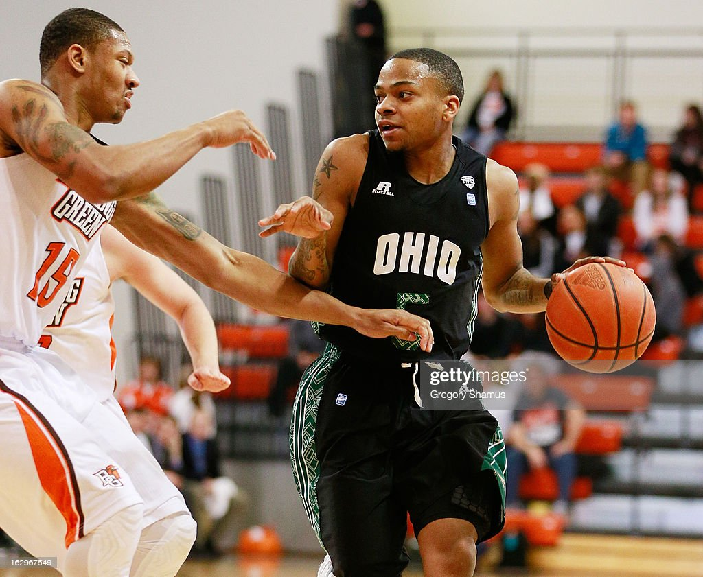 D.J. Cooper #5 of the Ohio Bobcats drives around A'uston Calhoun #15 of the Bowling Green Falcons during the first half at the Stroh Center on March 2, 2013 in Bowling Green, Ohio. Ohio won the game 78-65.