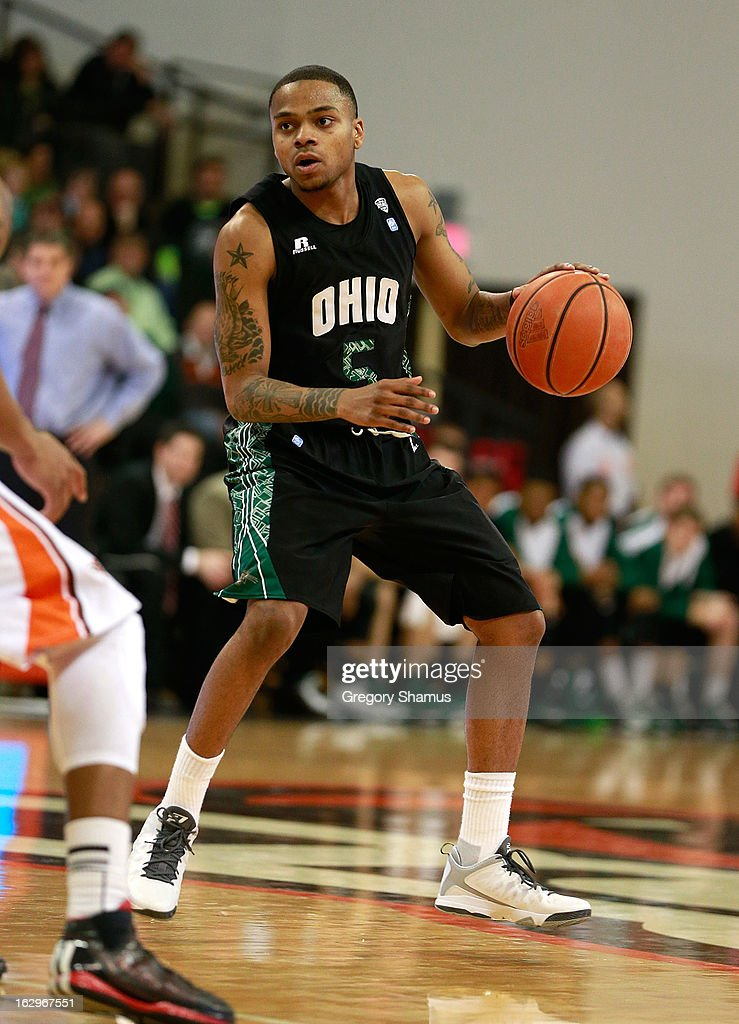 D.J. Cooper #5 of the Ohio Bobcats looks for a open teammate while playing the Bowling Green Falcons at the Stroh Center on March 2, 2013 in Bowling Green, Ohio. Ohio won the game 78-65.