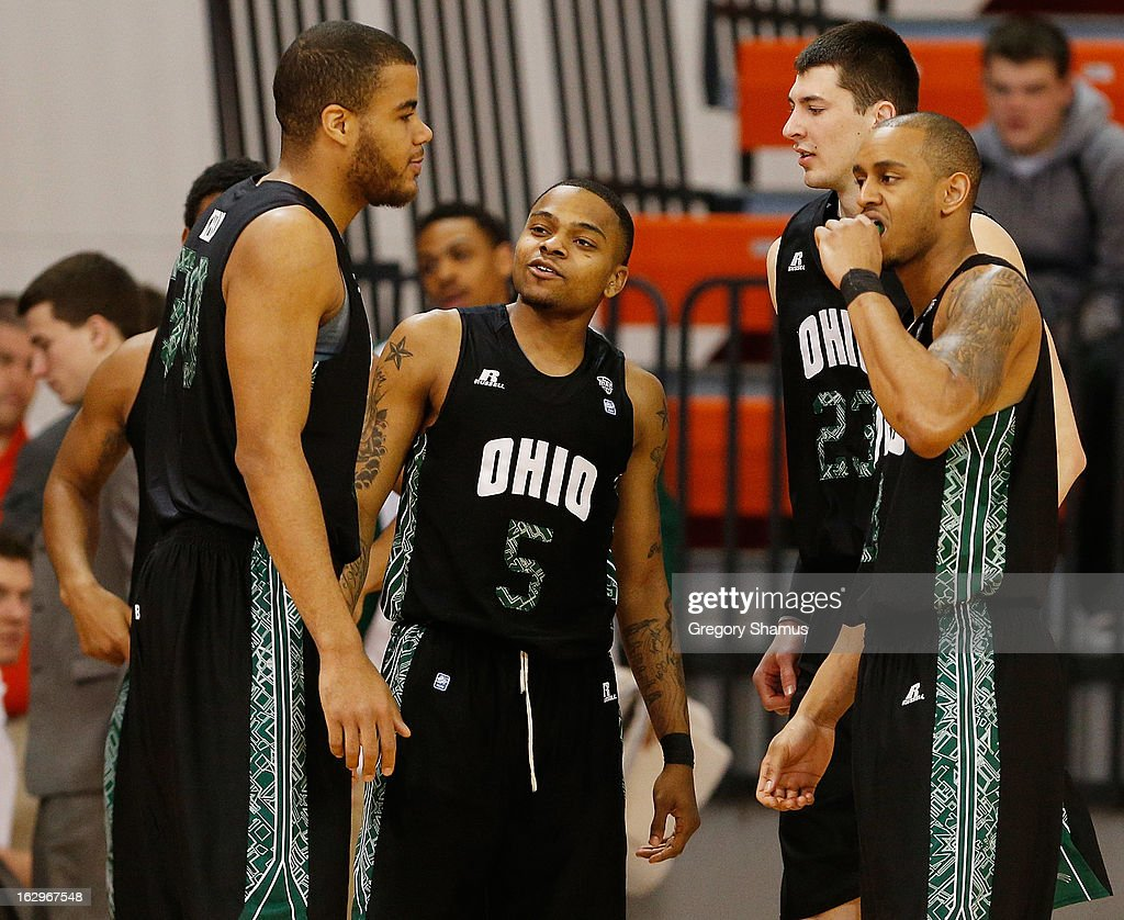 D.J. Cooper #5 of the Ohio Bobcats talks with teammates Reggie Keely #30, Ivo Baltic #23 and Walter Offutt #3 as they take the floor to play the Bowling Green Falcons at the Stroh Center on March 2, 2013 in Bowling Green, Ohio. Ohio won the game 78-65.