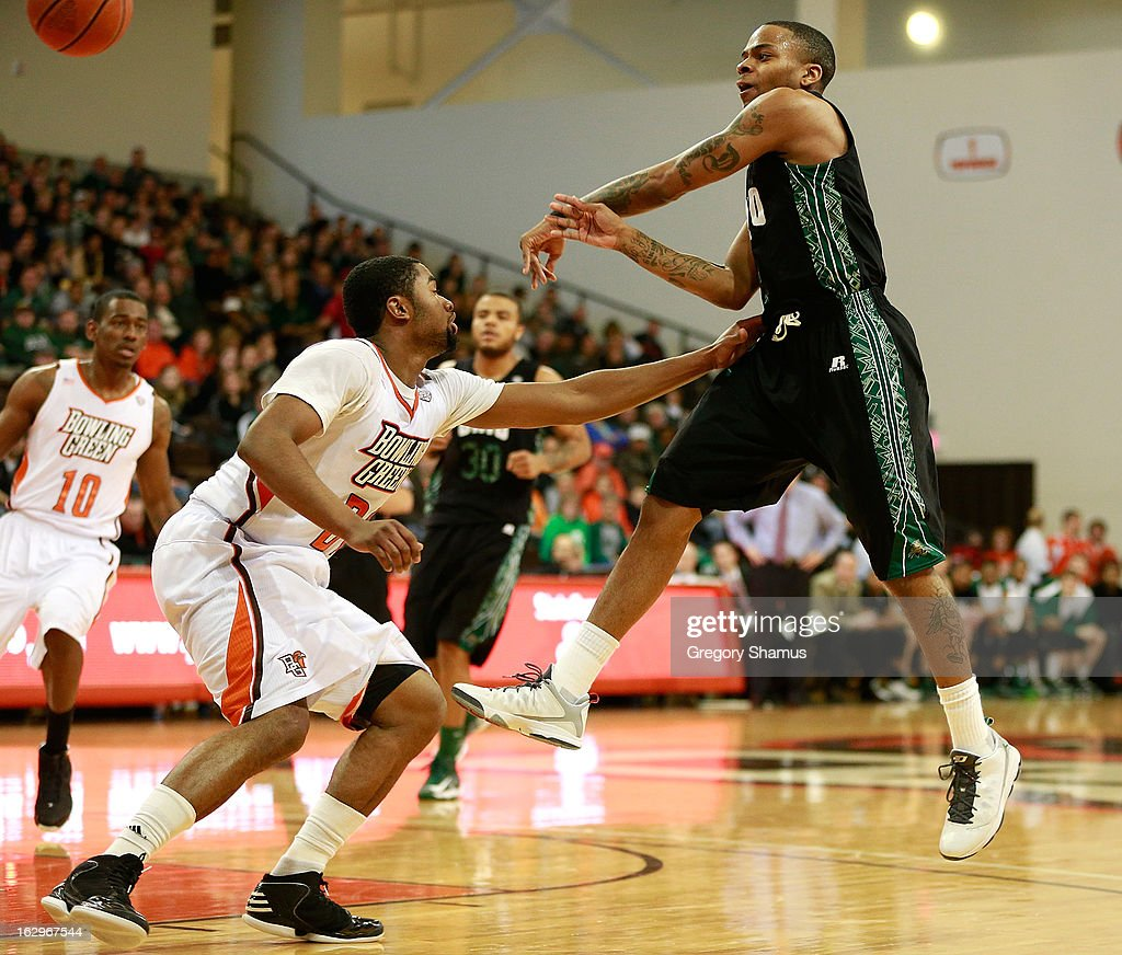 D.J. Cooper #5 of the Ohio Bobcats throws a pass over the defense of Chauncey Orr #21 of the Bowling Green Falcons during the first half at the Stroh Center on March 2, 2013 in Bowling Green, Ohio. Ohio won the game 78-65.