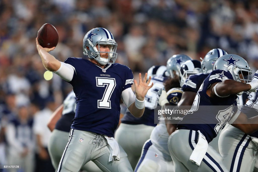 Cooper Rush #7 of the Dallas Cowboys passes the ball during a presason game against the Los Angeles Rams at Los Angeles Memorial Coliseum on August 12, 2017 in Los Angeles, California.
