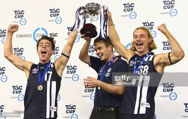 Cooper Stephens Daniel O'Keefe and James Worpel of Geelong hold the trophy aloft after winning the TAC Cup Grand Final match between Geelong and...
