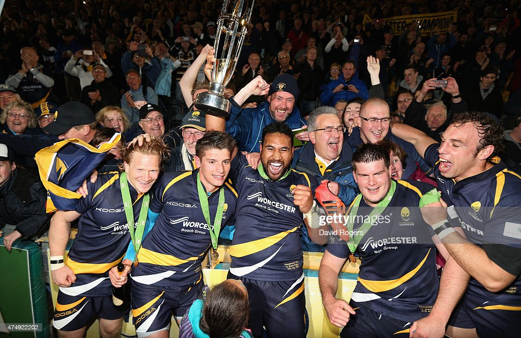 Cooper Vuna holds the trophy as he celebrates with team mates after Worcester Warriors win promotion during the Greene King IPA Championship Final...