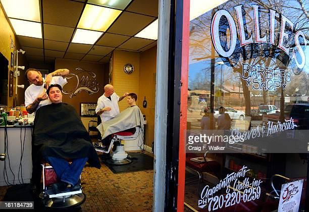 Cooper Wood gets a haircut from Brian Poskin left owner of Ollie's Barbershop in the Highlands neighborhood of Denver CO Friday March 09 2012 Poskin...