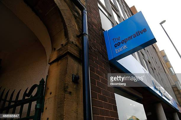 A CoOperative Bank Plc logo sits on a sign outside one of the bank's branches in Huddersfield UK on Wednesday May 7 2014 Former CoOperative Bank...