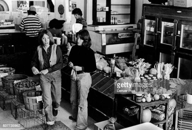 Cooperatives Nederland Co Jan Bishop left shows a coop member around the store manages the Mountain People's Cooperative in Nederland Credit The...