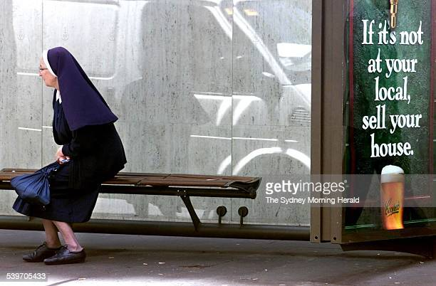 A Coopers beer commercial at a bus stop with a nun 23 October 2001 SMH Picture by PETER MORRIS