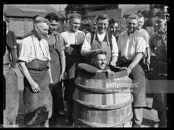 Coopers with a man in a barrel 1934 A photograph of coopers at Watney's Brewery in Mortlake London taken by George Woodbine for the Daily Herald...