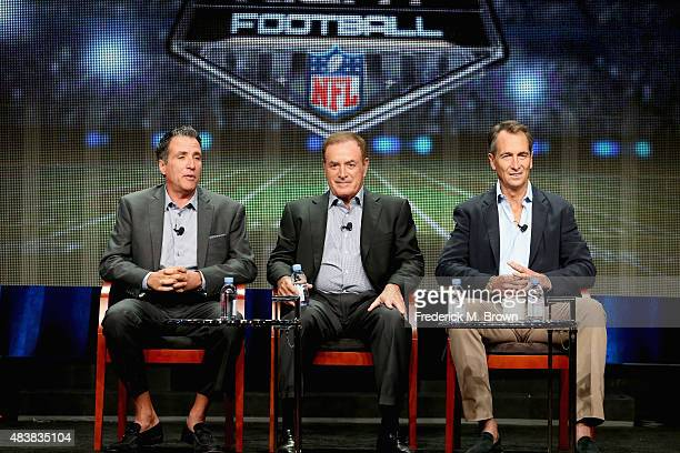 Coordinating producer Fred Gaudelli playbyplay announcer Al Michaels and analyst Cris Collinsworth speak onstage during NBC's 'Sunday Night Football'...