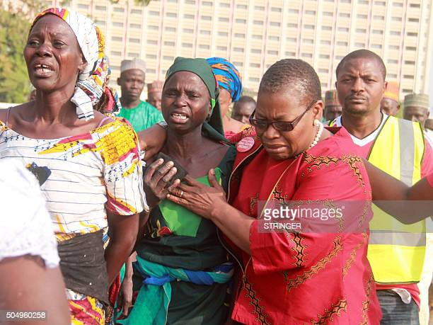 Coordinator of the 'Bring Back Our Girls' Nierian movement Oby Ezekwesili helps a mother sobing for her missing daughter abducted by Boko Haram...