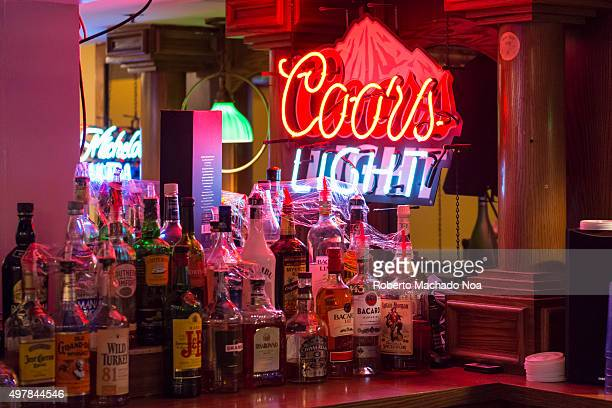 Coors Light signage seen from inside a bar in New York City United States Wine bottles of different brands seen in the foreground Coors Light is a...