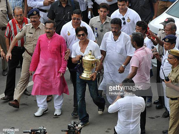KKR coowner and Bollywood actor Shahrukh Khan carrying IPL Trophy during felicitation ceremony of the IPL champions Kolkata Knight Riders on June 3...
