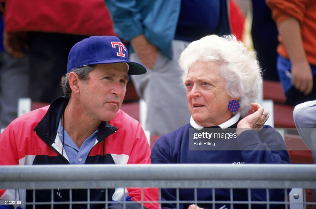 Coowner and managing general partner of the Texas Rangers George W Bush and mother Barbara Bush attend a Texas Rangers game circa 19891998 in...