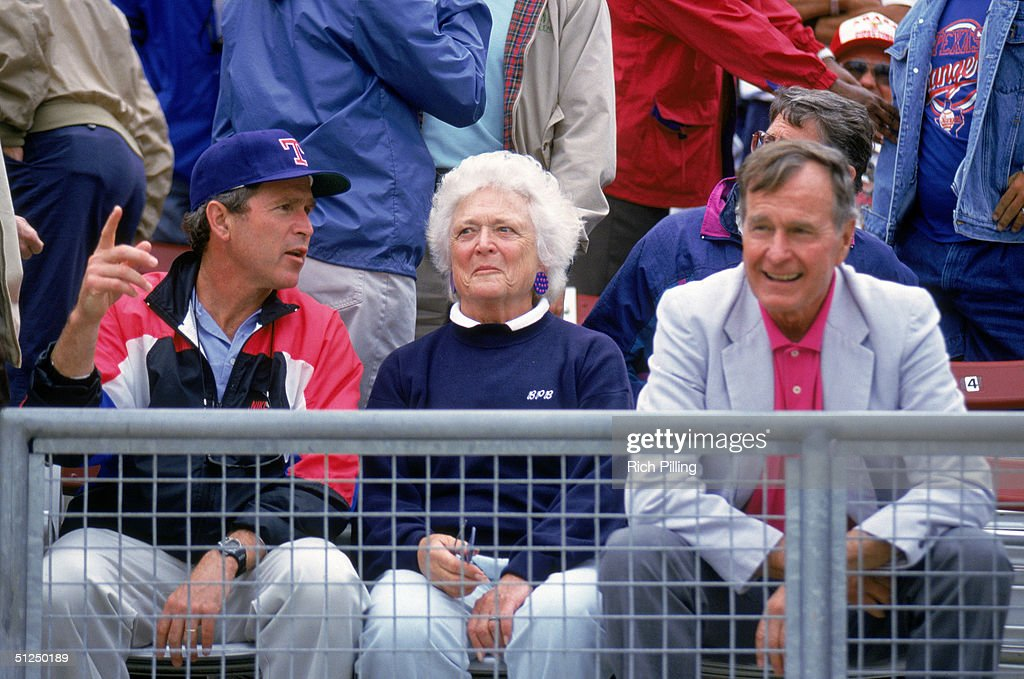 Coowner and managing general partner of the Texas Rangers George W Bush sits with his father and former US President George HW Bush and mother...