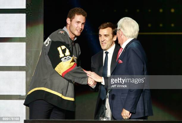 Coowner Bill Foley and general manager George McPhee of the Vegas Golden Knights greet defenseman Brayden McNabb onstage during the 2017 NHL Awards...