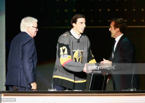 Coowner Bill Foley and general manager George McPhee of the Vegas Golden Knights greet defenseman MarcAndre Fleury onstage during the 2017 NHL Awards...