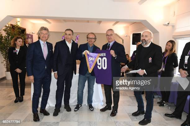Coowner of the ACF Fiorentina football team Andrea Della Valle gives a jersey as a present to Claudio Ranieri during an event organized to mark the...