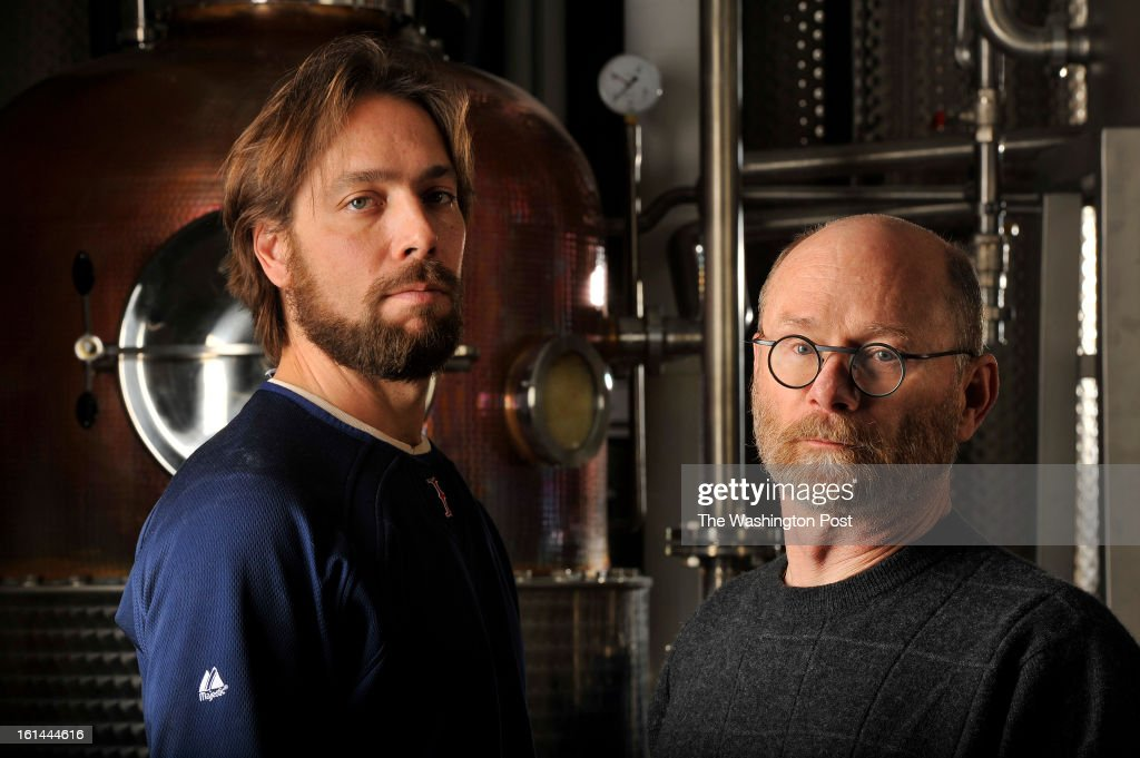 Co-owners and distillers, John Uselton, left, and Michael Lowe, right, pose for a portrait at their business, New Columbia Distillers LLC on Monday February 04, 2013 in Washington, DC. They produce Green Hat gin and hope to soon add a rye whiskey and seasonal gins.