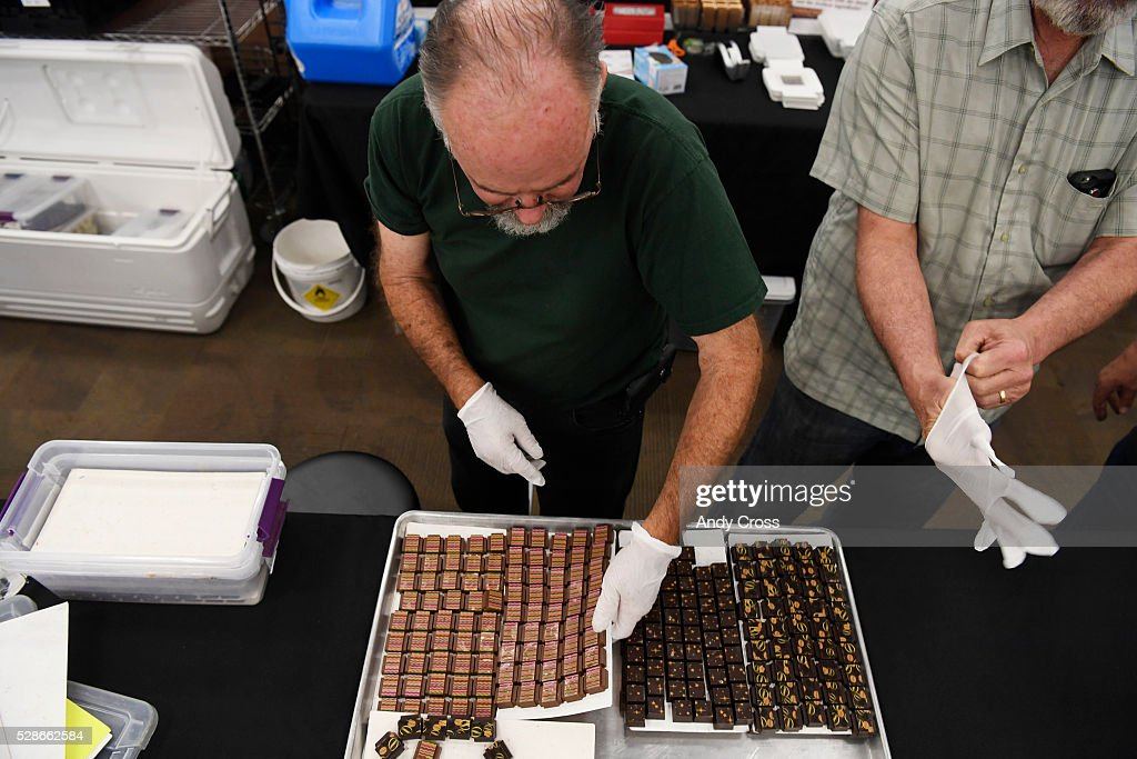 Co-owners of Tim and Larry's Elixir Boutique Chocolates from New Mexico Tim McNamara, right, and Larry Todd, left, set up for the Colorado Chocolate Festival at the Denver Mart May 06, 2016.