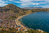 Complete cityscape of Copacabana city in the early morning seen from the Calvary Mountain by the Titicaca Lake, Bolivia, South America.