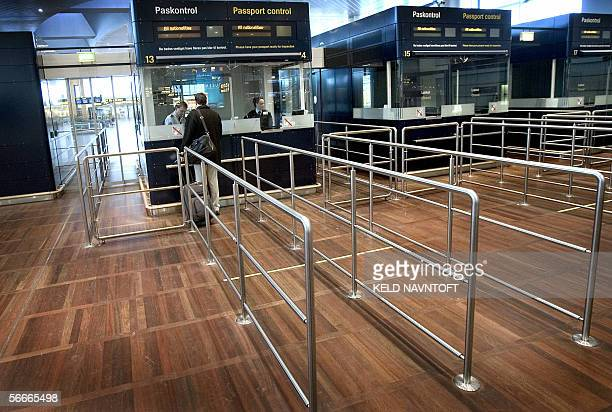 A lone passenger waits at the passport control 25 January 2006 in Copenhagen Airport Kastrup after SAS Scandinavian Airlines System cancelled all...