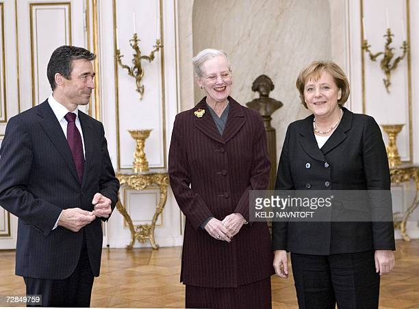 Danish Queen Margrethe poses with German Chancellor Angela Merkel and Danish Prime Minister Anders Fogh Rasmussen at the Amalienborg Palace in...