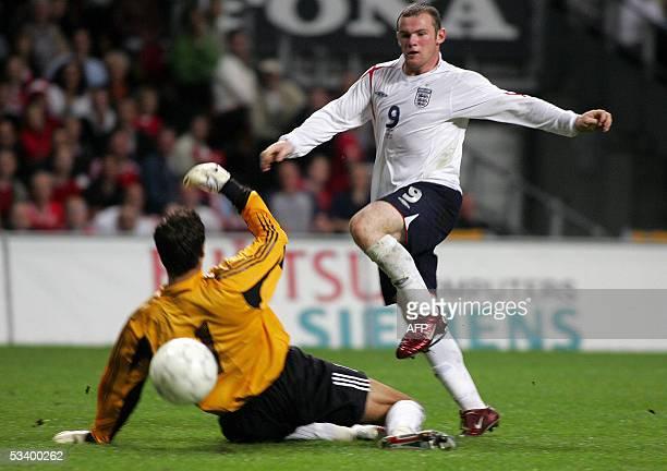 Englands Wayne Rooney scores past Denmark's Thomas Srensen during their friendly international soccer match at the Parken Stadium in Copenhagen 17...