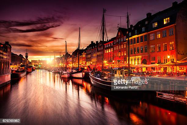 Copenhagen famous canal with boats and typical architecture